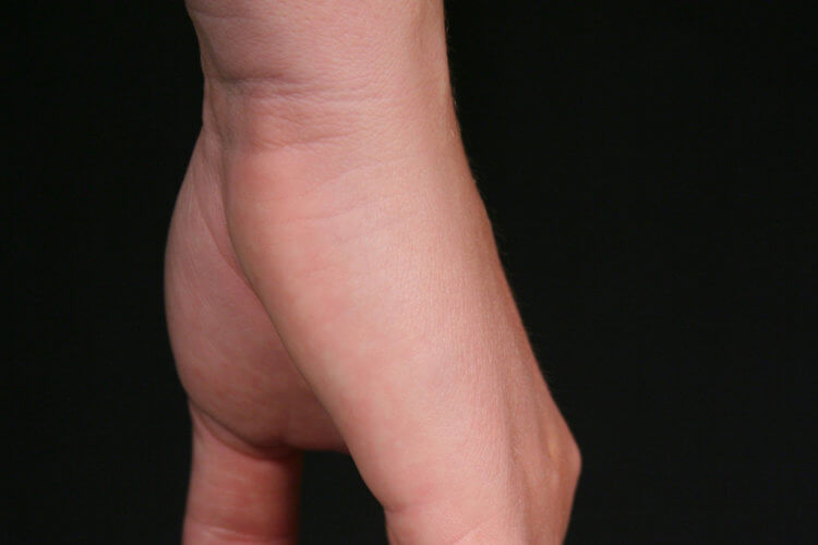 Child holding moms hand
